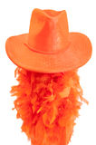Hat and boa on white background as tipical accessories on the Koningsdag in Amsterdam. Royalty Free Stock Photography