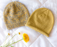 Hat bound manually of different color wool and natural flower. Hat bound manually of different color wool and flower Stock Photo