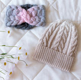 Hat bound manually of different color wool and natural flower. Hat bound manually of different color wool and flower Stock Photography