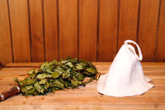 Hat and broom in russian bath-house Royalty Free Stock Photo