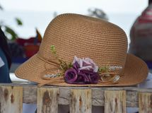 Cover Up from the heat. Hat. Brown hat with purple flower. Perfect for visit the beach. Cover from the Sun Royalty Free Stock Photography