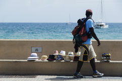 Hat buyer in the Port of Cannes France. Hat buyer walk away what to buy near the sea in palma de mallorca ,Spain Stock Image