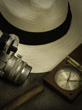 Hat camera and compass Royalty Free Stock Photo
