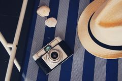 Hat, camera and shells. stock photography