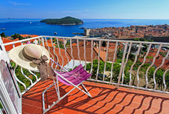 Hat on chair in luxury balcony of Dubrovnik royalty free stock photography