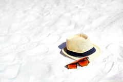 Hat and colorful sunglasses Stock Photos