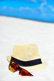 Hat and colorful sunglasses Stock Images