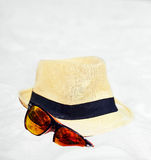 Hat and colorful sunglasses Royalty Free Stock Images