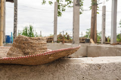Hat in construct site. Hat in building construct area cement pillar in construct site Stock Photo