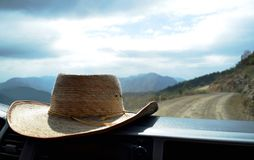 Hat on the dashboard inside a car royalty free stock photo