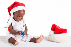 That hat is different. A 8 month old baby dressed to explore Christmas Stock Images