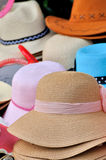 Hat in different color. Various of straw hat in different color and size and repeated shape, shown as same type and small difference or colorful dress and Royalty Free Stock Photography