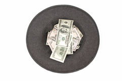 Hat with dollar banknotes Royalty Free Stock Images