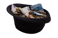 Hat with donated money. The hat can be used as donate button Stock Photos