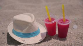 Hat and drinks on tropical beach. In sunny and hot day. Beach is very clean and sand is quite good stock video footage
