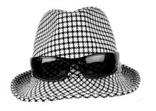 Hat with eyes. Vintage hat with sunglasses on it Stock Image
