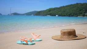 Hat and Flip-flop Shoes on the Sandy Beach on Tropical Island. HD Background Footage for Travel Agency Website. Thailand. Hat and Flip-flop Shoes on the Sandy stock footage