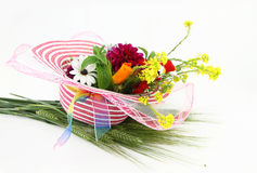 Hat and flower bouquet Stock Images