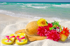 Hat and Flowers on Beach Royalty Free Stock Photos