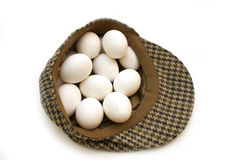 Hat full of eggs Royalty Free Stock Image