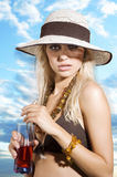 Hat girl with drink Stock Images
