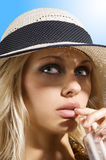 Hat girl with drink Royalty Free Stock Photos
