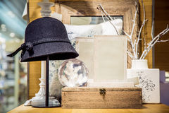 Hat, glass ball and decorative pillow. View of black hat, glass ball and decorative pillow in souvenir shop Stock Images