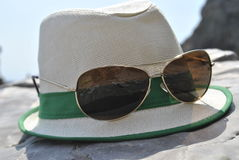 Hat and glasses. Hat and accelerate on the stone stock image