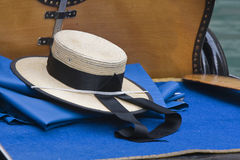 Hat by gondoliers. Hat typical Venetian gondolier laid on gondola Stock Images