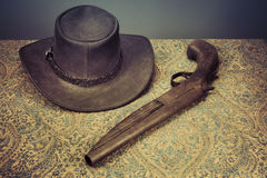 Hat and gun Royalty Free Stock Image