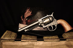 Hat and gun. Cowboy hat with feather and gun Royalty Free Stock Image