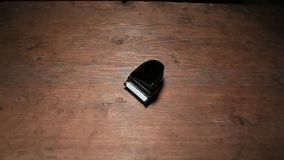 Hat hand black piano wooden table hd footage. Studio