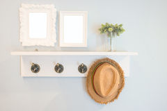 Hat hang on the  wall with picture frames Stock Photo