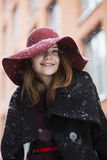Hat hide woman eye under light snowfall Royalty Free Stock Photo