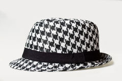Hat with a houndstooth pattern Stock Photography