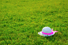 Hat on the lawn. Royalty Free Stock Photos