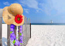 Hat and Lei on Fence Royalty Free Stock Photos