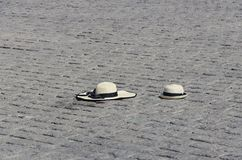 A hat lost on the ground. Texture and background A hat on the ground Straw hat Stock Photos