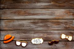 Hat, moustache, glasses, bow tie and copy for Happy Father Day party on wooden background top view copy space.  stock image