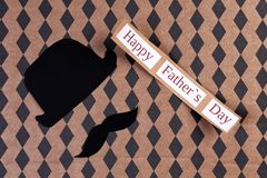 Hat and mustache on color background. Father`s day celebration Royalty Free Stock Photography