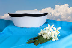 Hat nurse white and Millingtonia hortensis flowers. On blue fabric. symbol of nursing thailand and Thai traditional medicine. Object with work paths for cutout royalty free stock images