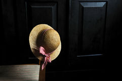 Hat on an old chair Royalty Free Stock Photos