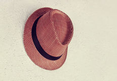 Hat  on an old  wall vintage retro effect Royalty Free Stock Photography