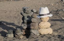 Hat over the rocks Royalty Free Stock Images