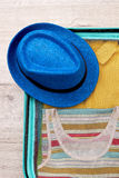 Hat, packed suitcase for trip. Royalty Free Stock Photos