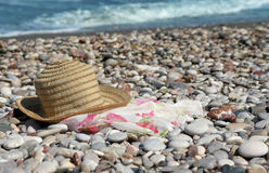 Hat with pareo on the beach Royalty Free Stock Image