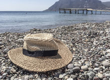 Hat on a pebbly beach Stock Photography
