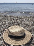 Hat on a pebbly beach Stock Photo