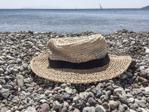Hat on a pebbly beach Stock Images