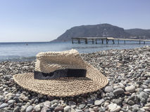 Hat on a pebbly beach Stock Image